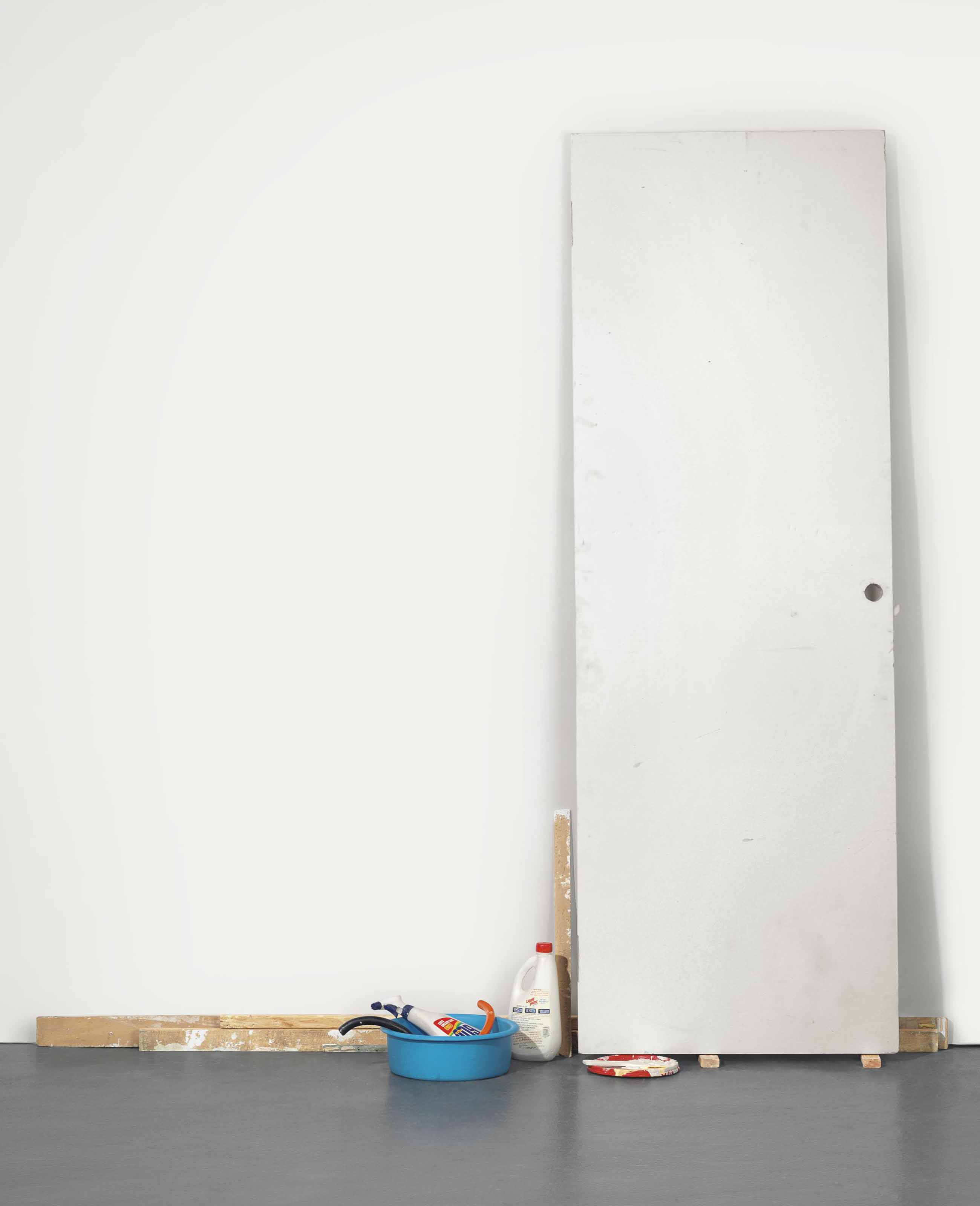 Untitled (Door with cleaning supplies)