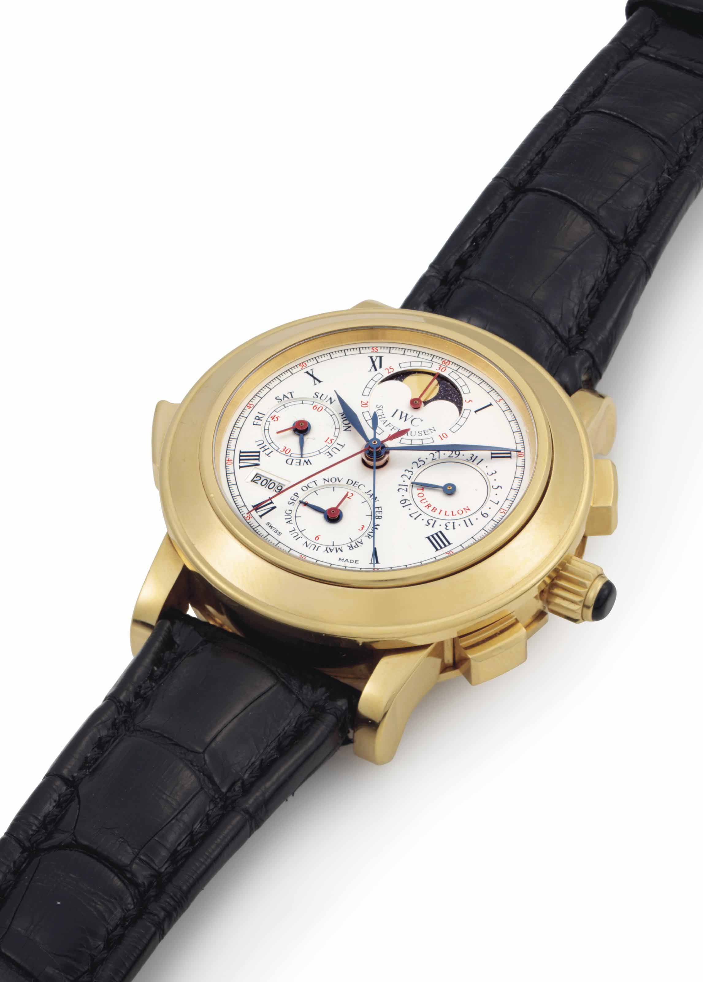 IWC. A Very Rare, Fine and Large 18k Gold Limited Edition Perpetual Calendar Minute Repeating Split Second Chronograph Tourbillon Wristwatch with Digital Year Display and Moon Phases