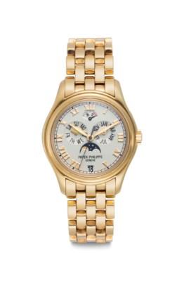 Patek Philippe A Fine 18k Gold Automatic Annual Calendar Wristwatch Center Seconds Power