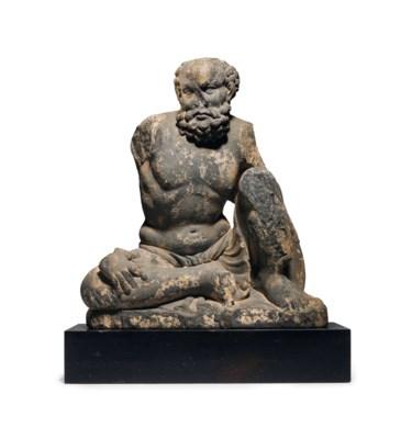 A gray schist figure of an Atl