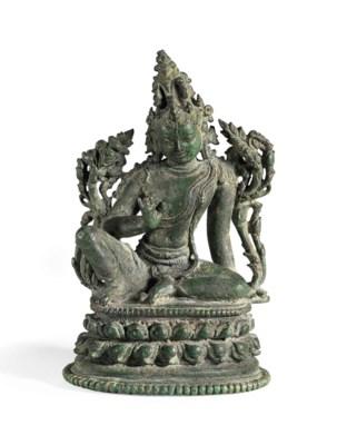 A bronze figure of Maitreya