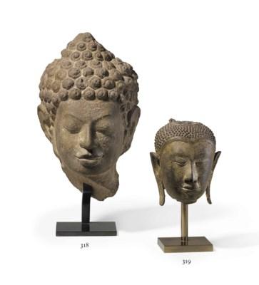 A bronze head of Buddha