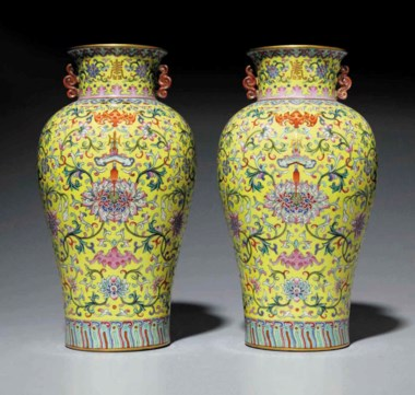 A very rare and superbly enamelled pair of yellow-ground famille rose vases, Jiaqing six-character seal marks in iron red and of the period (1796-1820). 12⅜  in (31.5  cm) high, wood stands. Sold for $2,045,000 on 16 September 2016  at Christie's in New York