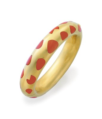 A CORAL AND GOLD BANGLE BRACEL