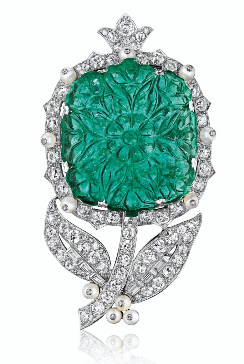 An emerald, pearl and diamond flower brooch, by Cartier, property from the Blair Family Collection. Sold for $487,500 on 7 December 2016  at Christie's in New York. Emeralds are very soft compared to diamonds or sapphires, so carving an emerald, like this flower blossom, without breaking it is a testament to the carver's expertise. This brooch incorporates the influential Indian