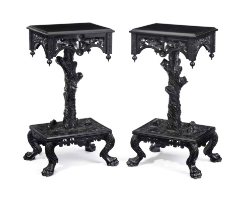 A PAIR OF CARVED EBONIZED CHER