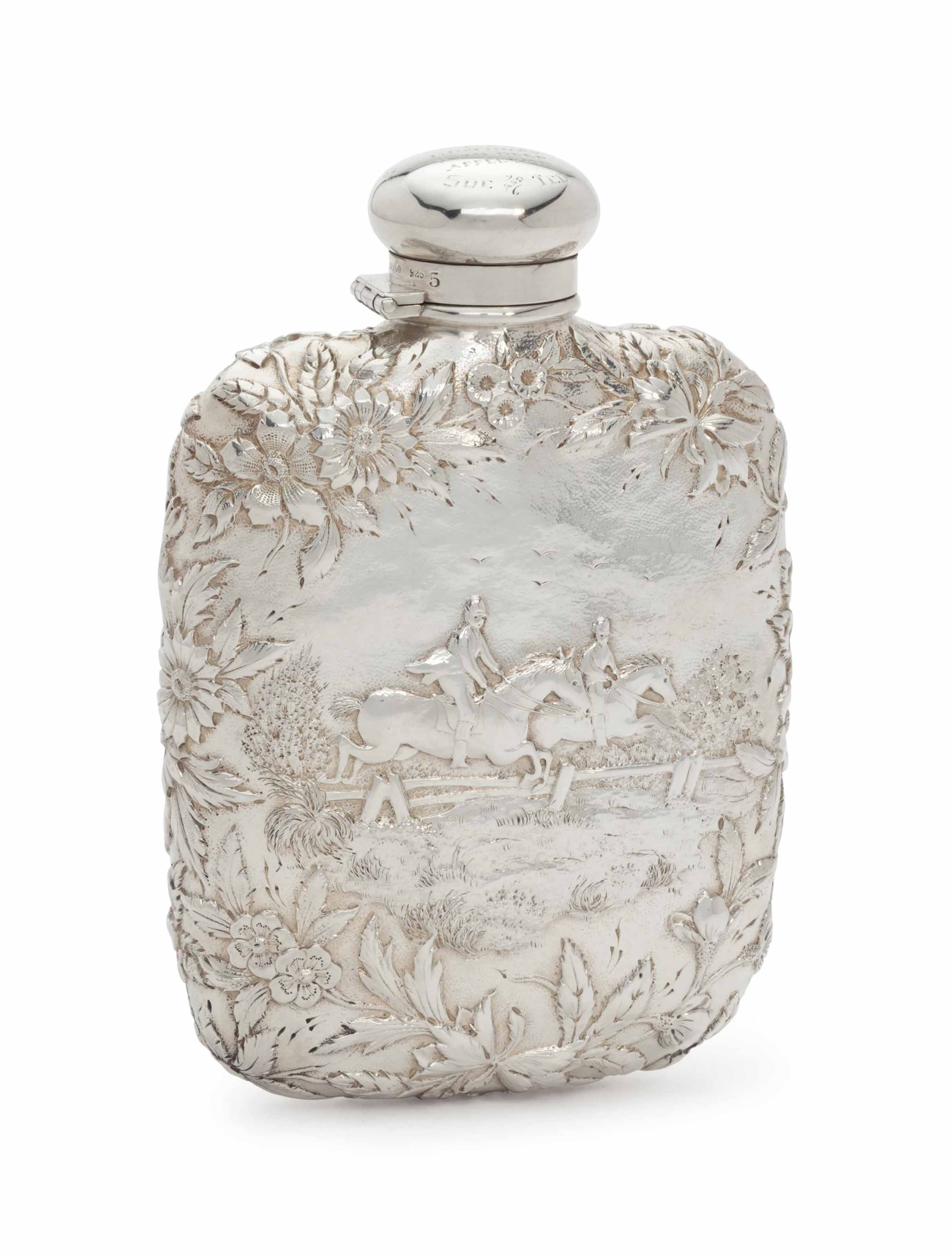 PRESIDENT RONALD REAGAN A 70TH BIRTHDAY GIFT, FEBRUARY 6, 1981  AN AMERICAN SILVER REPOUSSE FLASK