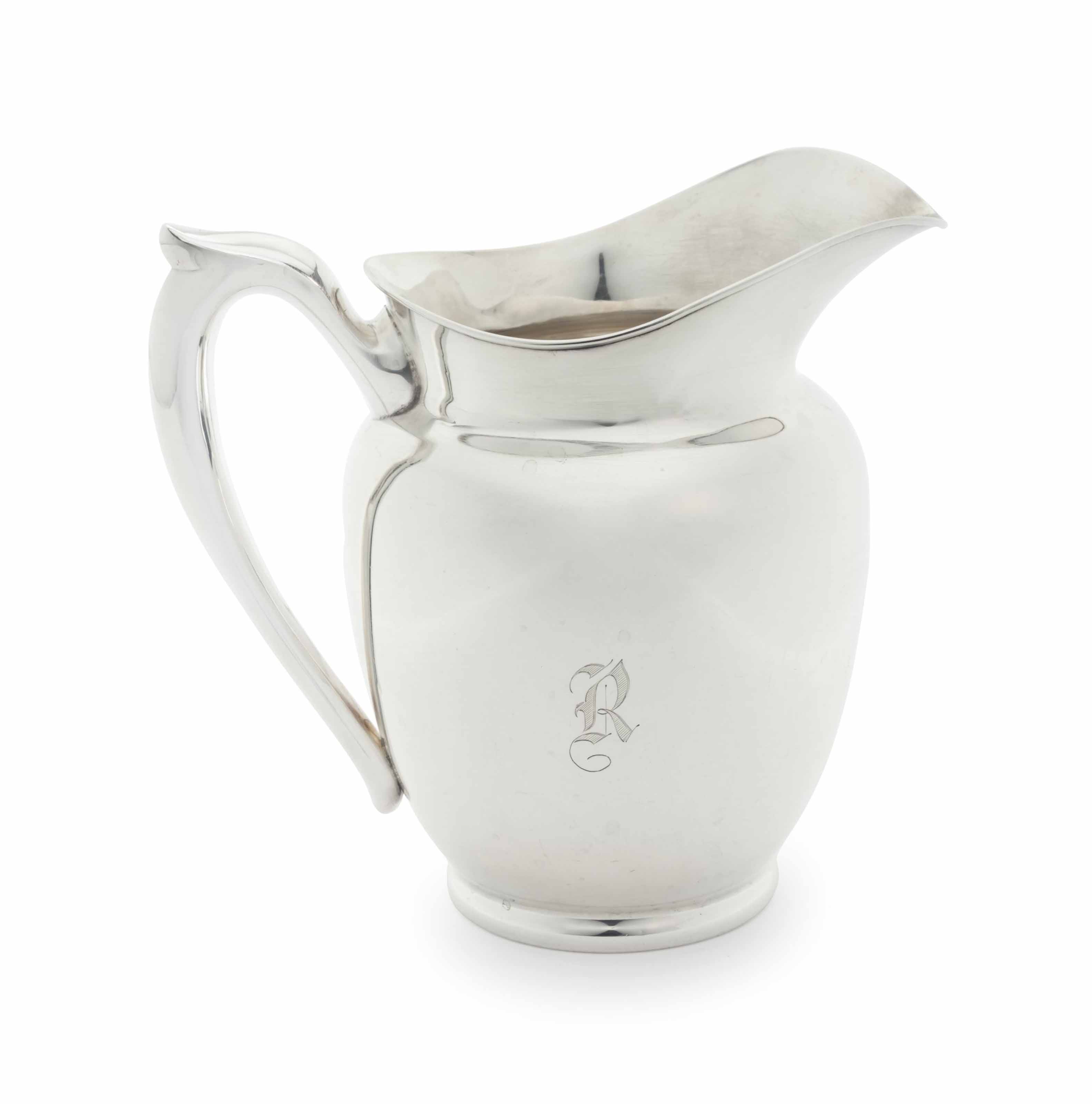 PRESIDENT AND MRS. RONALD REAGAN  AN AMERICAN SILVER WATER PITCHER