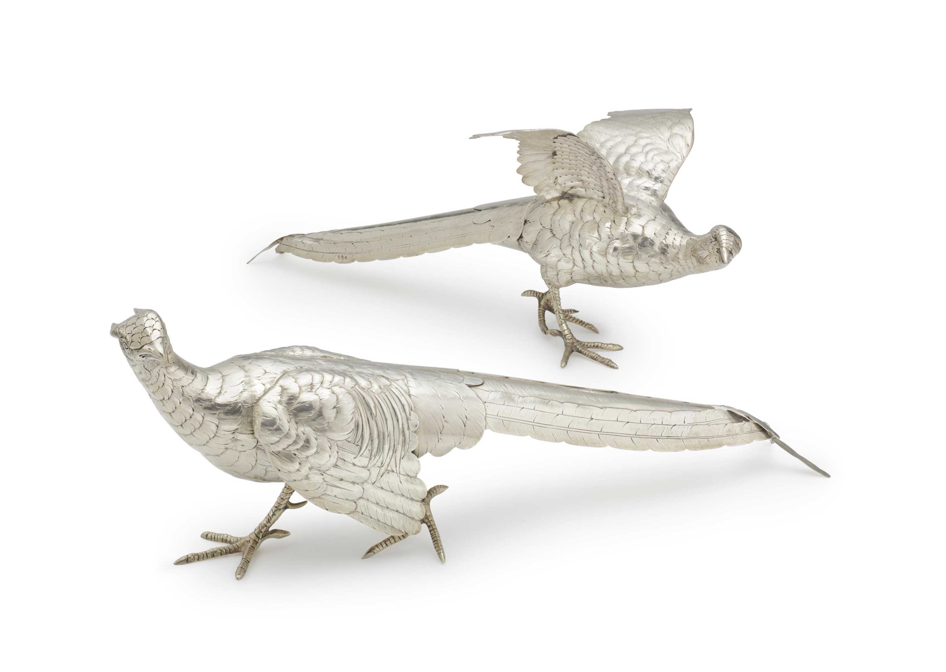 A PAIR OF GERMAN SILVER PHEASANT TABLE ORNAMENTS