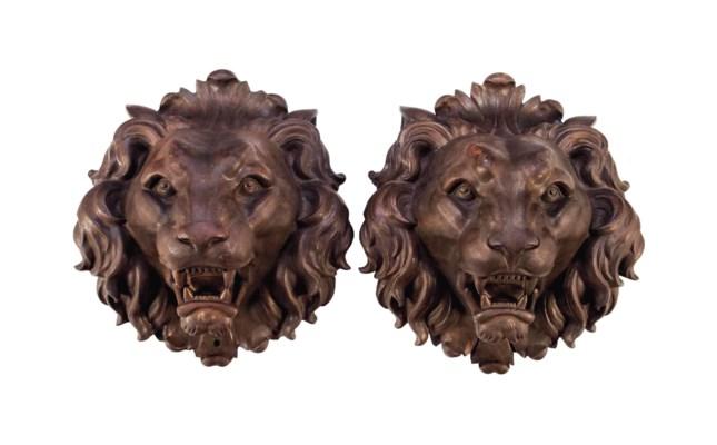 A PAIR OF LARGE CAST IRON LION