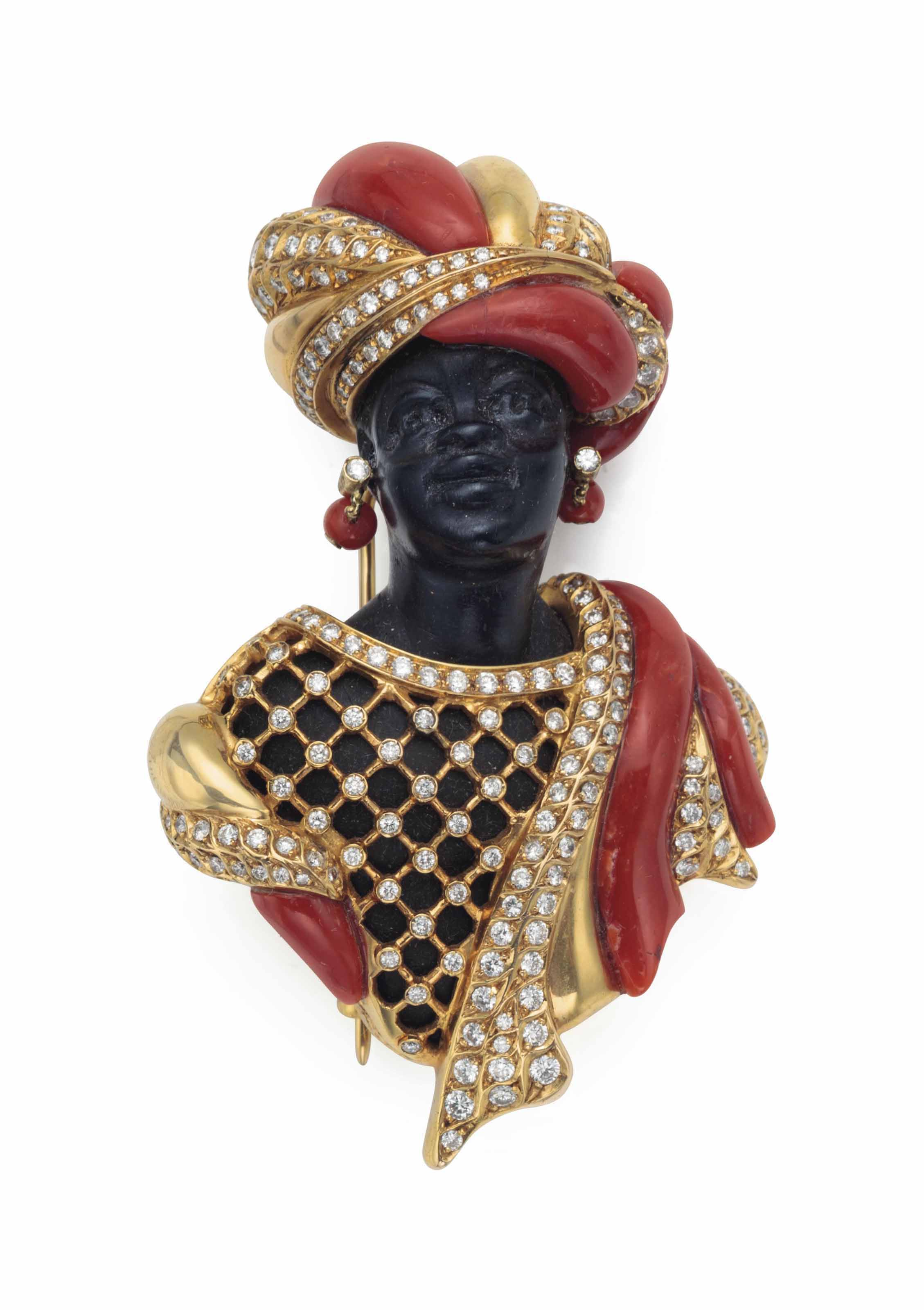 A GOLD, DIAMOND AND CORAL FIGURAL BROOCH