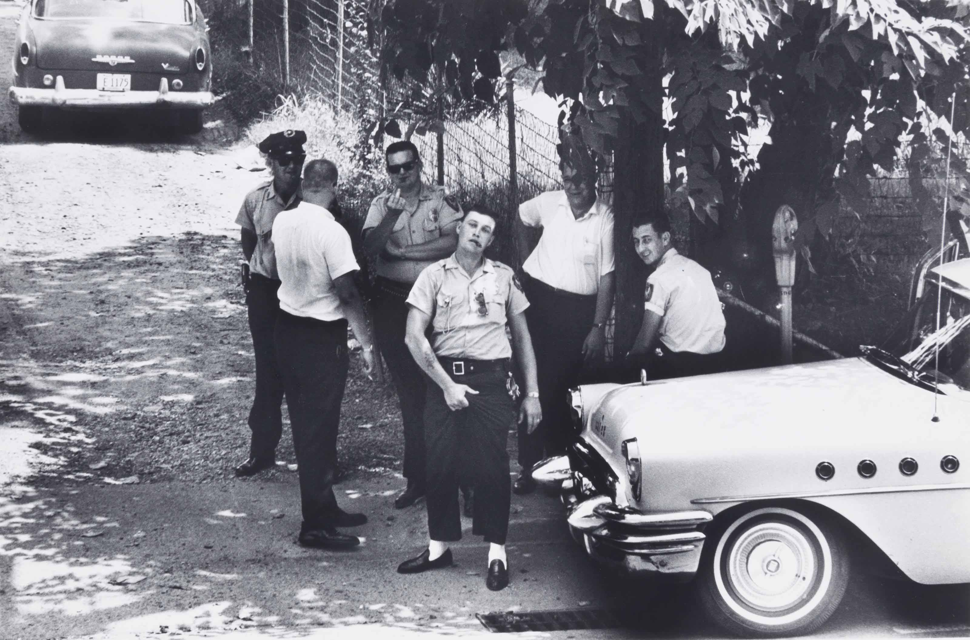 Police pose for a photograph as ministers from the National Council of Churches march to a local church, Clarksdale, Mississippi, 1963