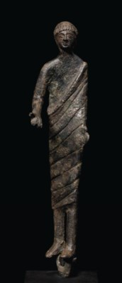 AN ETRUSCAN BRONZE MALE VOTARY