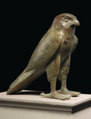 AN EGYPTIAN BRONZE FALCON