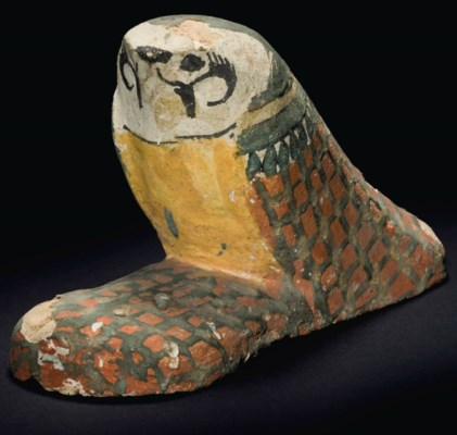 AN EGYPTIAN PAINTED WOOD FALCO