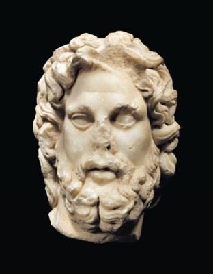 A ROMAN MARBLE HEAD OF ASCLEPI