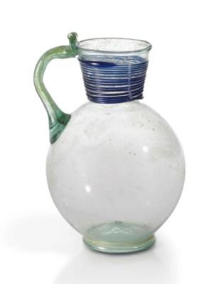 A LATE ROMAN PALE GREEN GLASS
