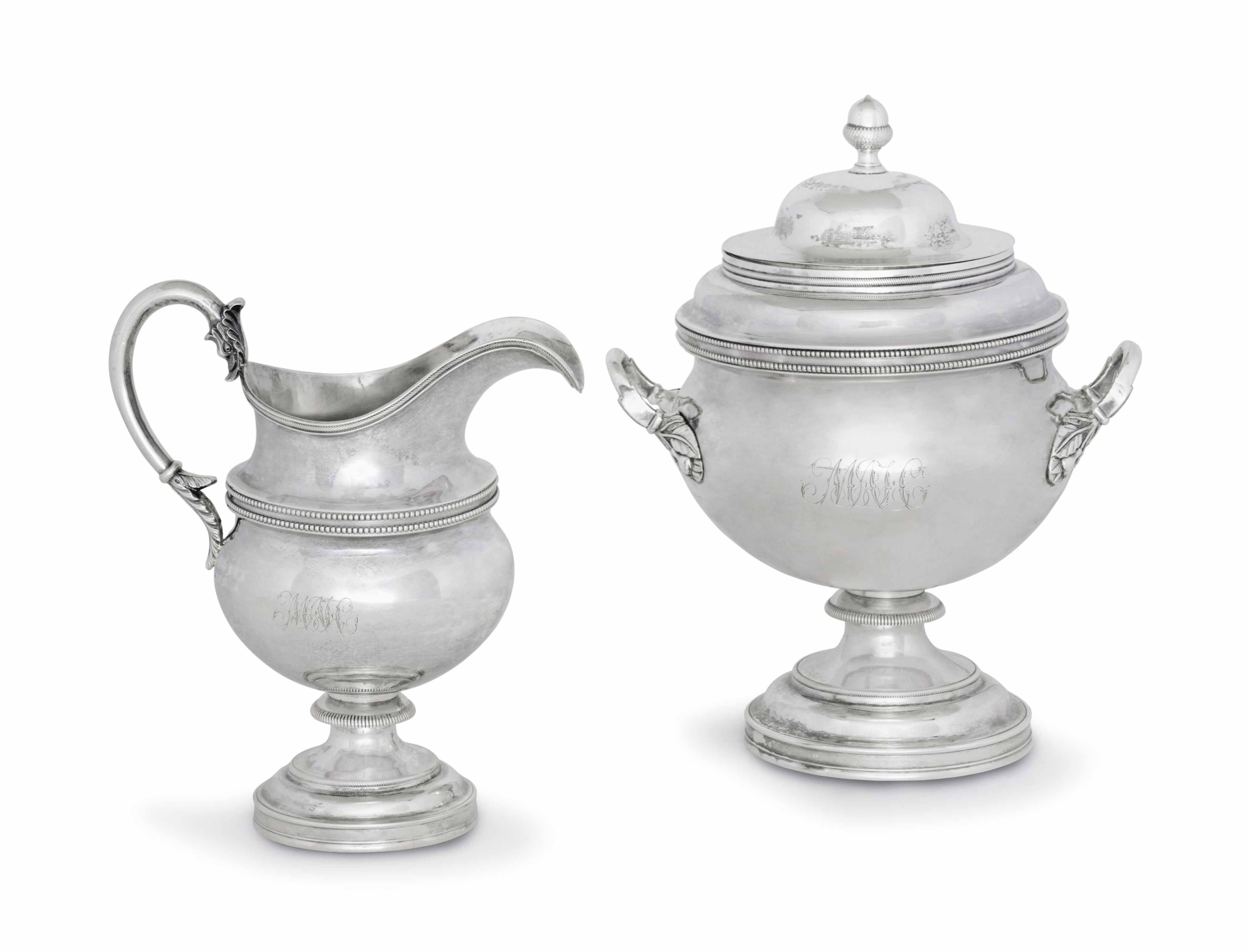 AN EARLY SILVER MILK JUG AND A TWO-HANDLED SUGAR BOWL AND COVER