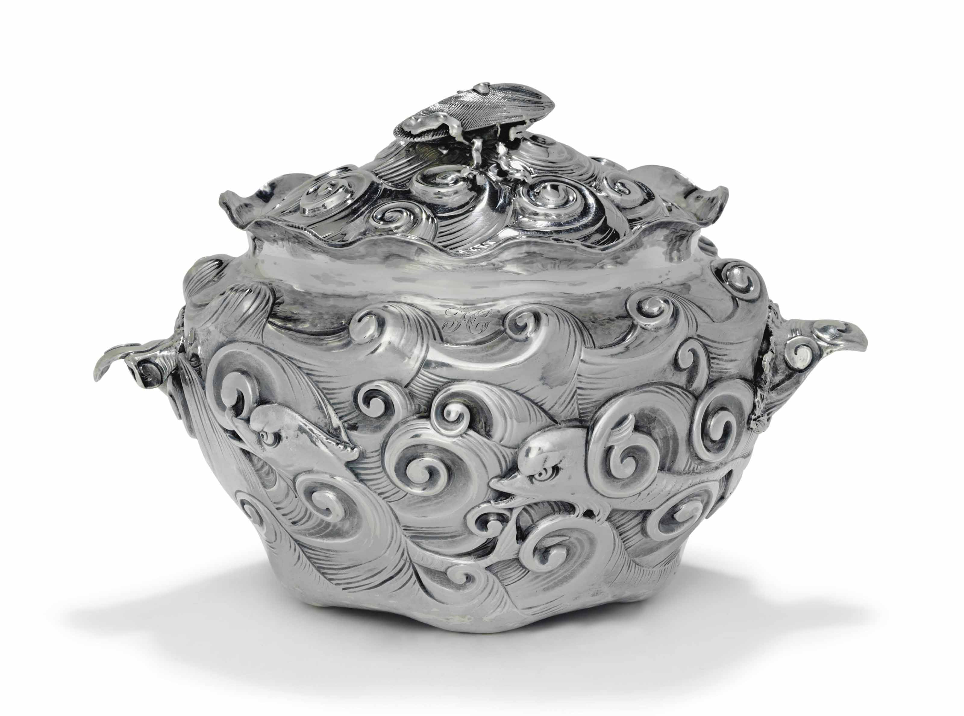 A SILVER TUREEN AND COVER