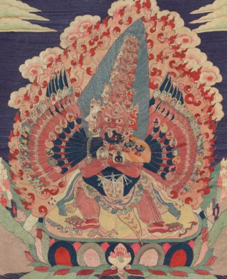 A SILK EMBROIDERED THANGKA OF
