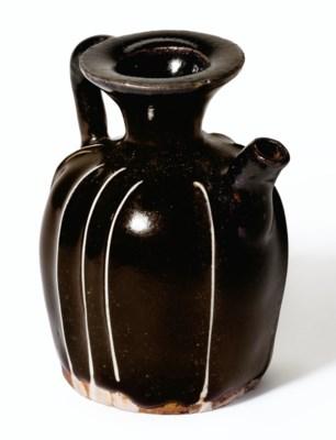 A MINIATURE BLACK-GLAZED EWER