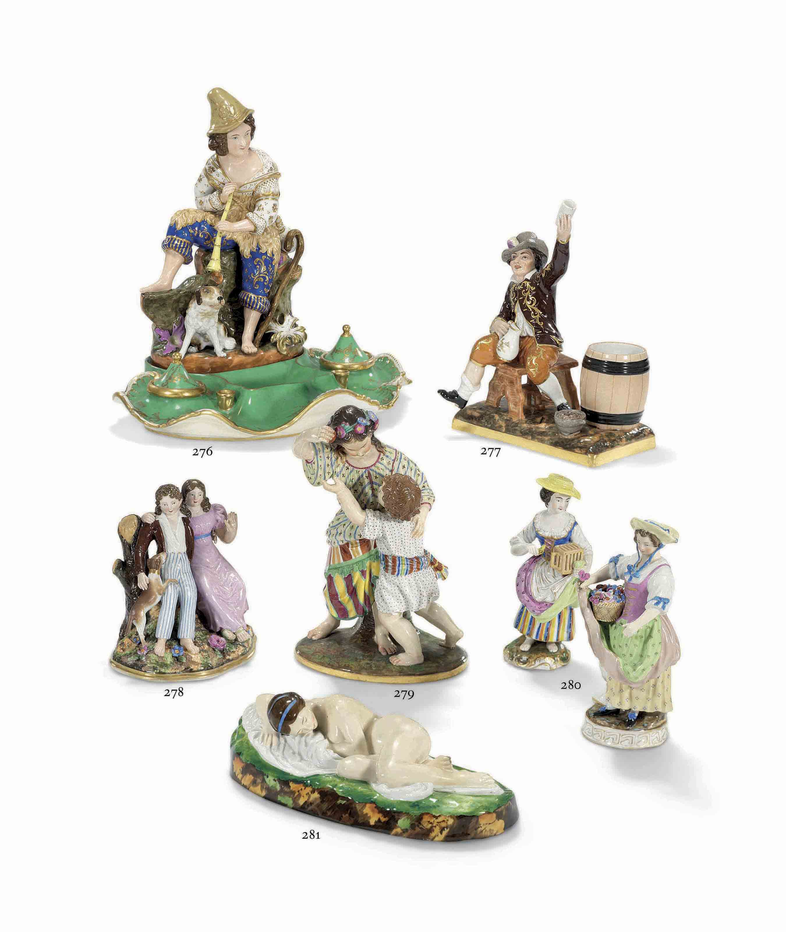 A PORCELAIN GROUP OF PLAYING CHILDREN