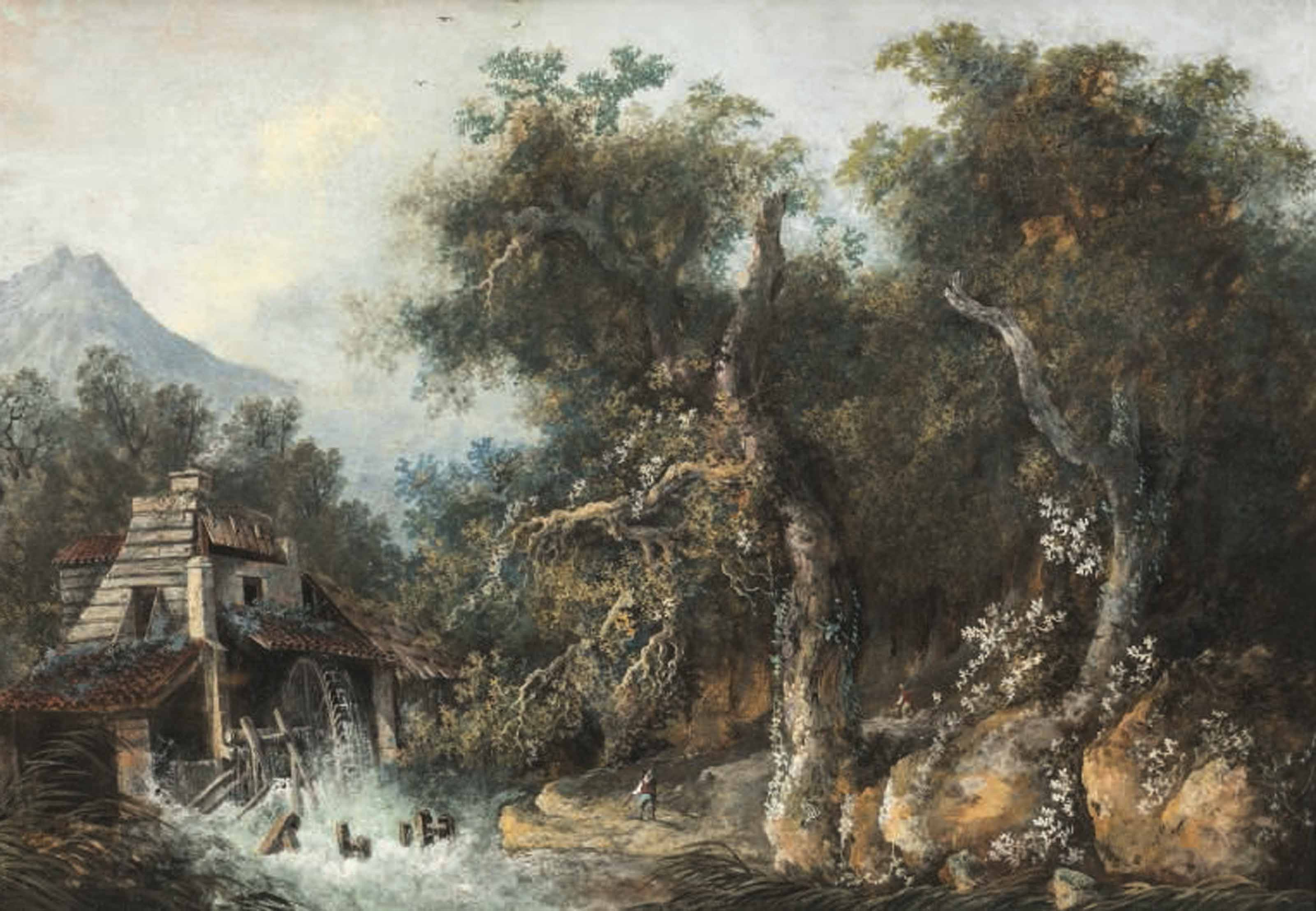 A watermill in a wooded landscape