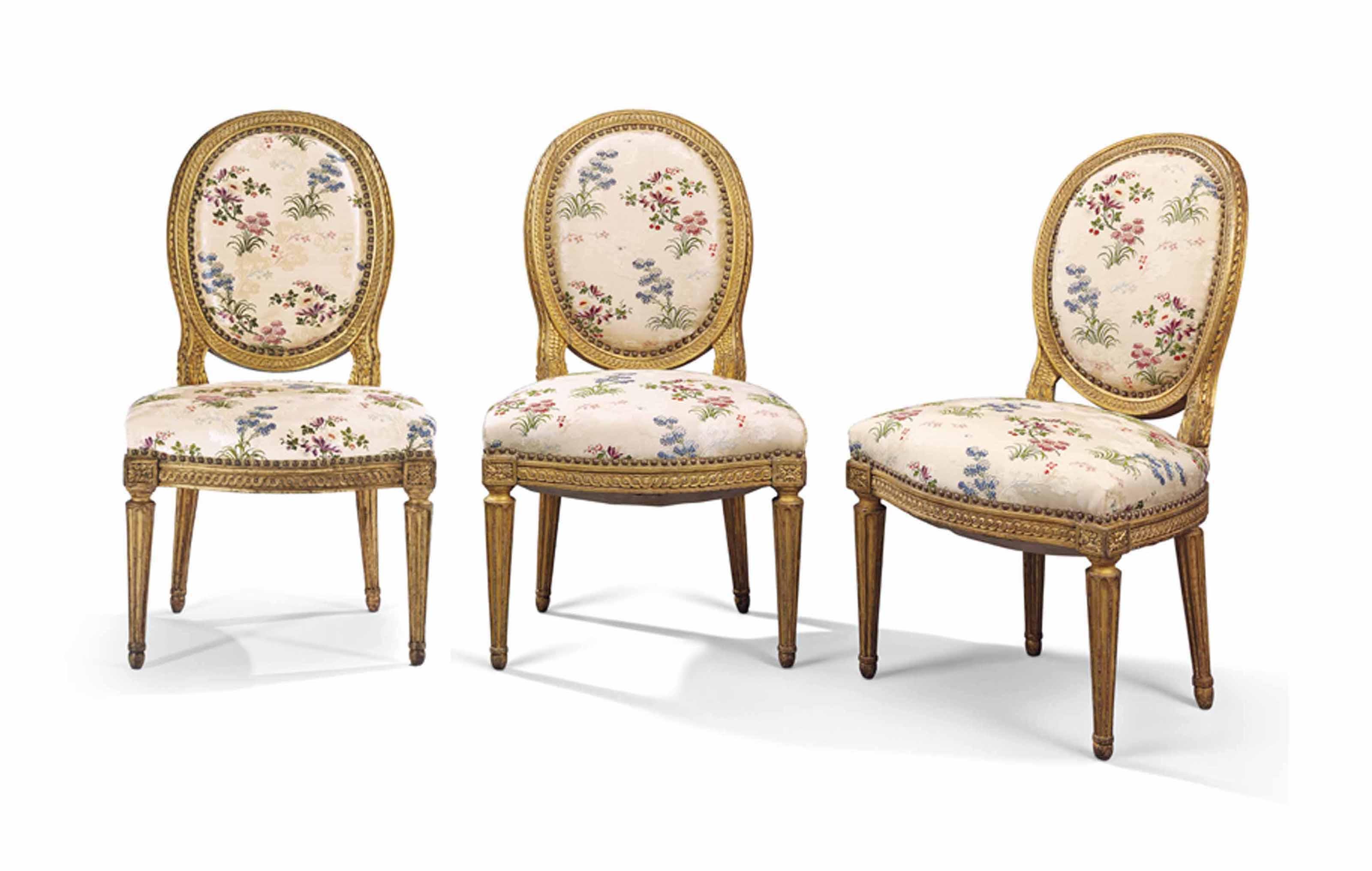 A SET OF THREE LOUIS XVI GILTWOOD CHAIRS