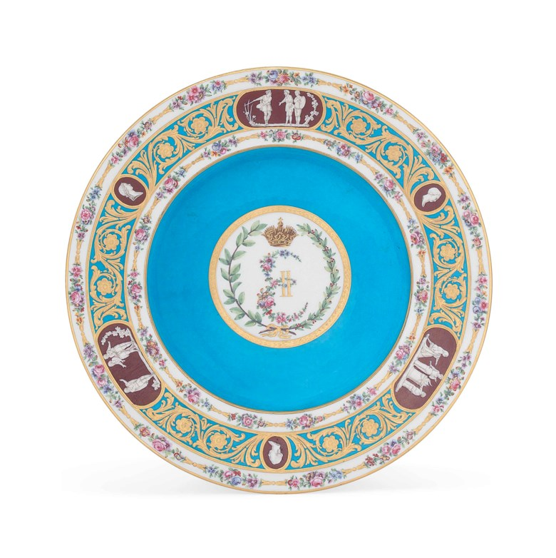 A Sèvres bleu celeste-ground soup-plate from the Catherine the Great service, 1778, blue interlaced L mark enclosing date letters AA, iron-red gilders mark 2000 for Henry-François Vincent, the reverse applied with various printed and script collection and exhibition labels. 26.6  cm (10½  in)  diam. Sold for £137,000 on 4 July 2017  at Christie's in London
