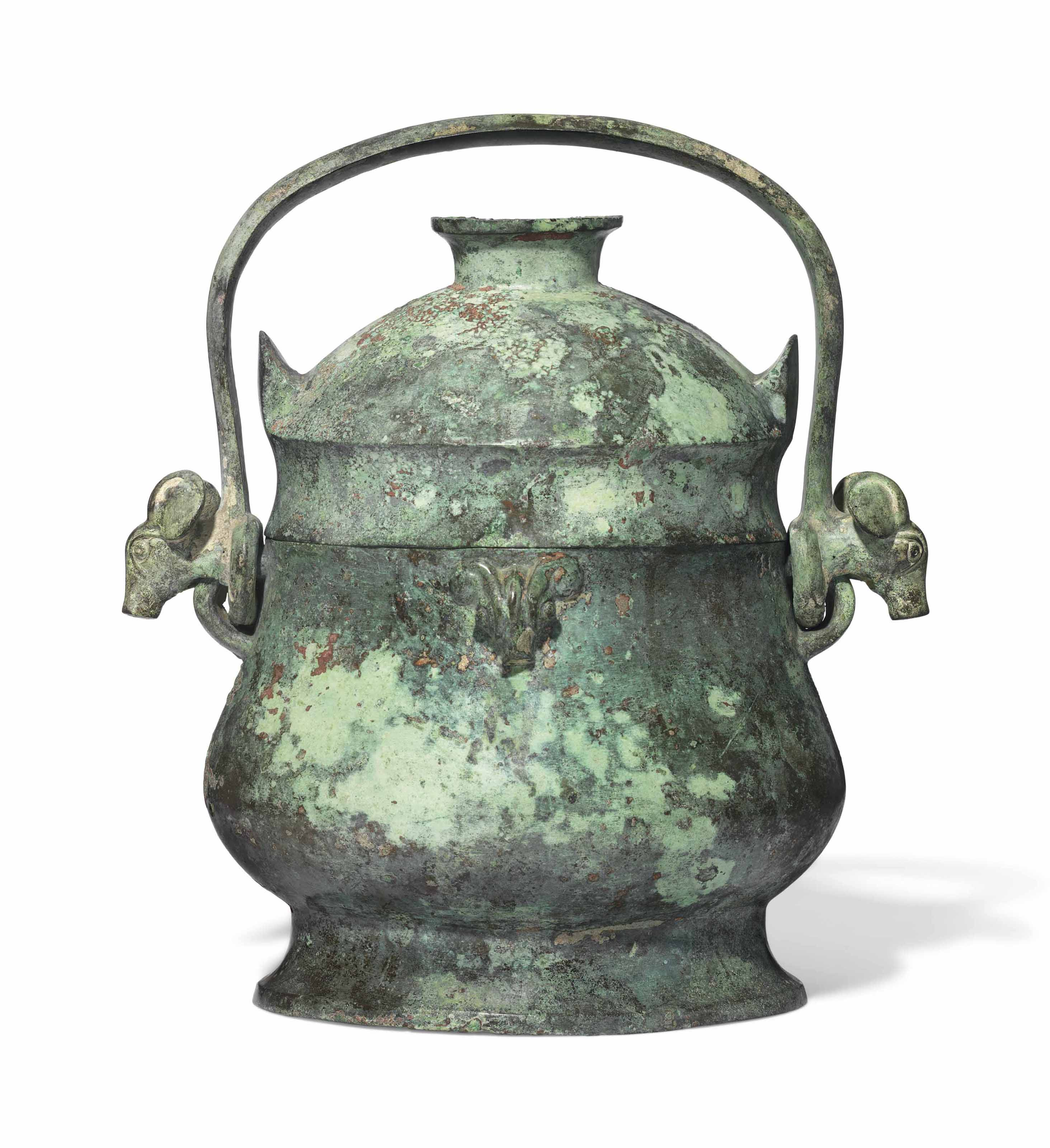 A bronze ritual wine vessel and cover, You, early Western Zhou dynasty (11th-10th century BC). 11  in (28  cm) high. Estimate £80,000-120,000. This lot is offered in Fine Chinese Ceramics & Works of Art on 7 November 2017  at Christie's in London