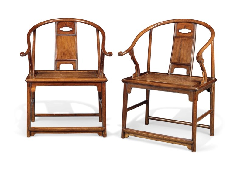 An extremely rare and important pair of huanghuali horseshoe-back armchairs, quanyi, Ming dynasty, 17th century. Each 26¾  in (68  cm) wide, 21  in (53.3  cm) deep, 36  in (91.5  cm) high. Estimate £800,000-1,200,000. This lot is offered in Fine Chinese Ceramics & Works of Art on 7 November 2017  at Christie's in London