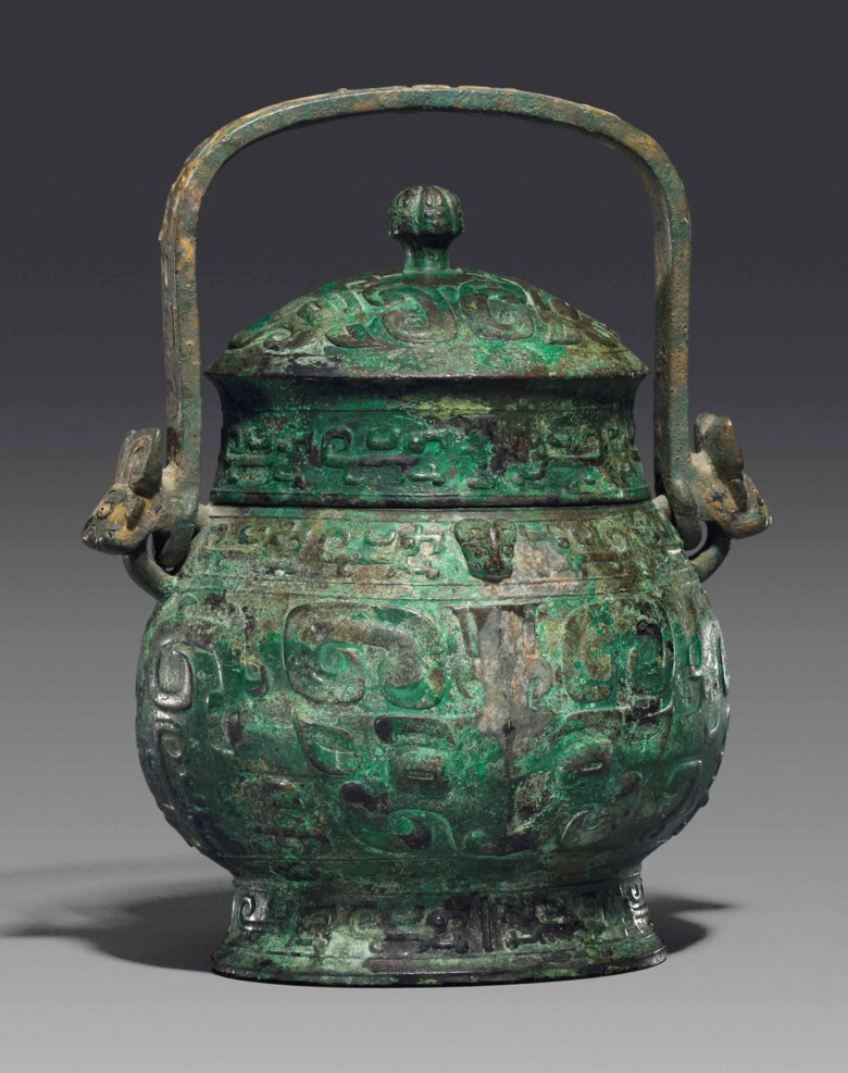 A bronze ritual wine vessel and cover, you, Late Shang dynasty (1600-1100 BC). 13  in (33  cm) high. Estimate £80,000-120,000. This lot is offered in Fine Chinese Ceramics & Works of Art on 7 November 2017  at Christie's in London