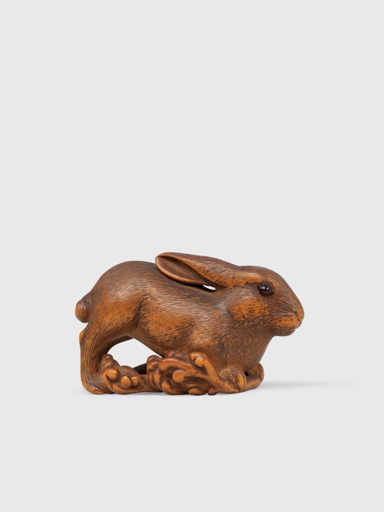 A wood netsuke of a lunar hare, signed Hoichi (Yoshikazu), Edo period (19th century). 4.4 cm long. This lot was offered in Art of Japan on 5 December 2017  at Christie's in London and sold for £3,000