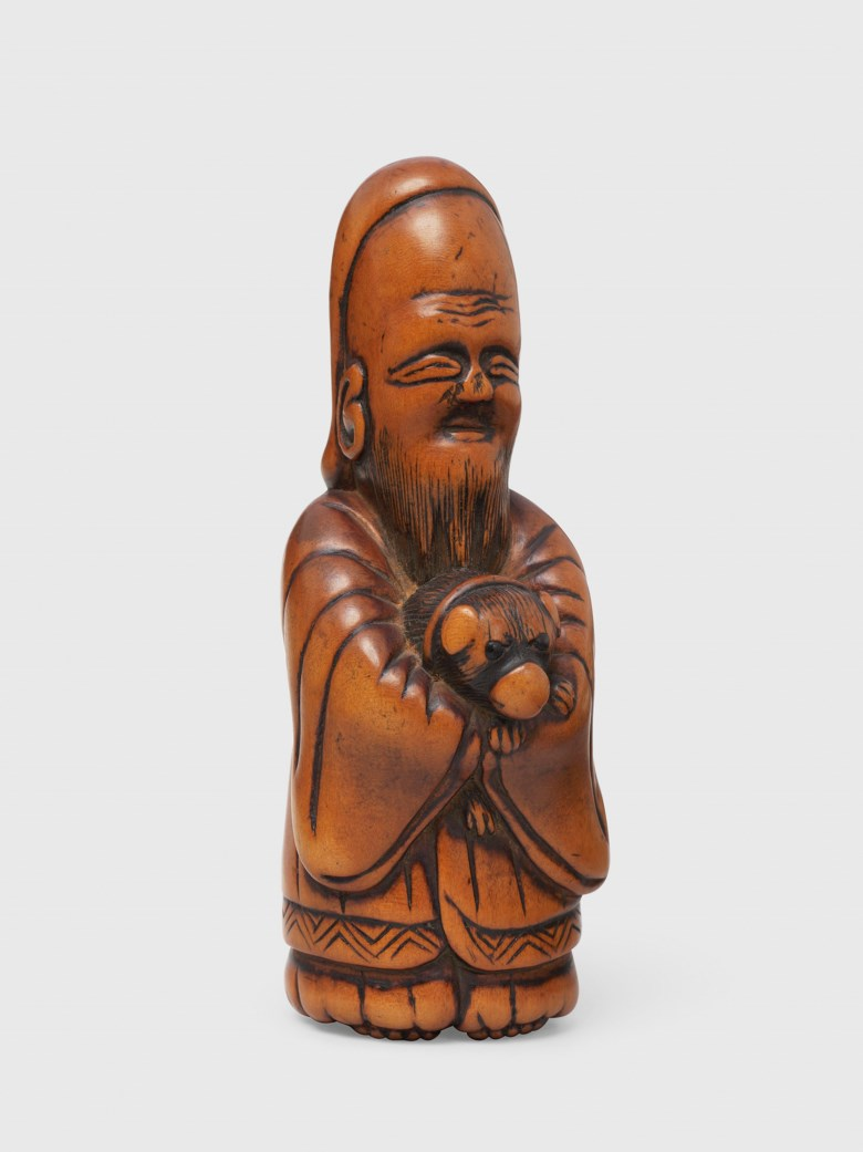 A wood netsuke of Fukurokuju, Edo period (18th century). 8 cm high. This lot was offered in Art of Japan on 5 December 2017  at Christie's in London and sold for £1,250