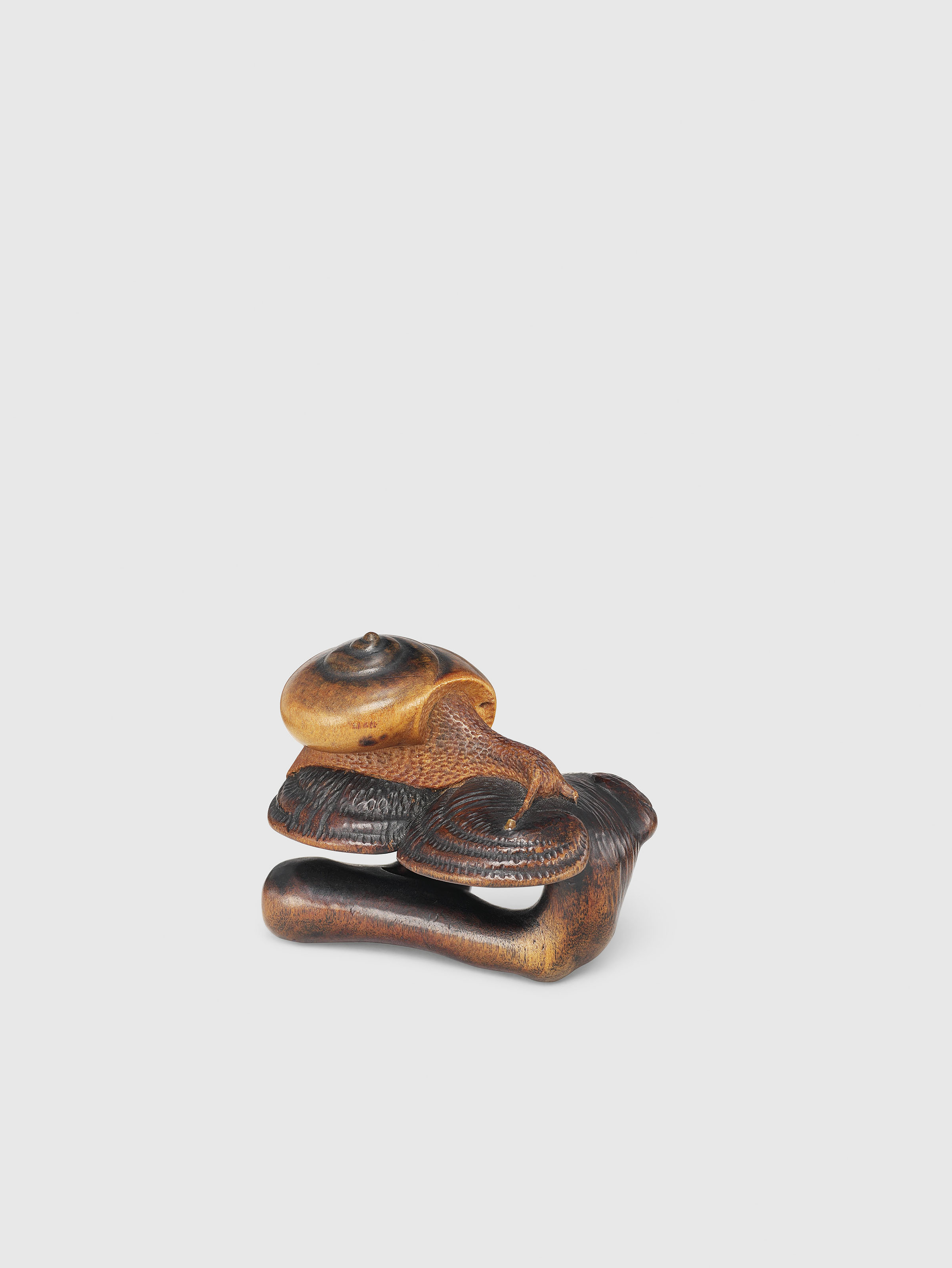 A WOOD NETSUKE OF A SNAIL AND FUNGUS
