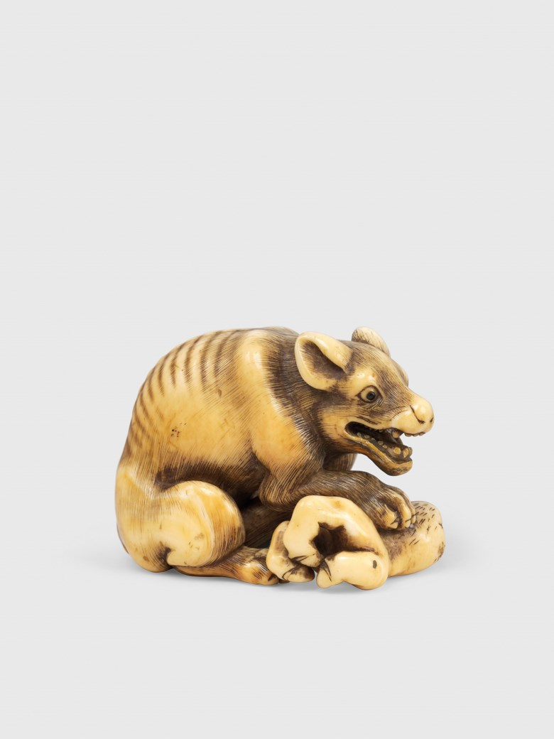An ivory netsuke of a wolf, signed Okamoto, Edo period (18th century). 3.8 cm high. This lot was offered in Art of Japan on 5 December 2017  at Christie's in London