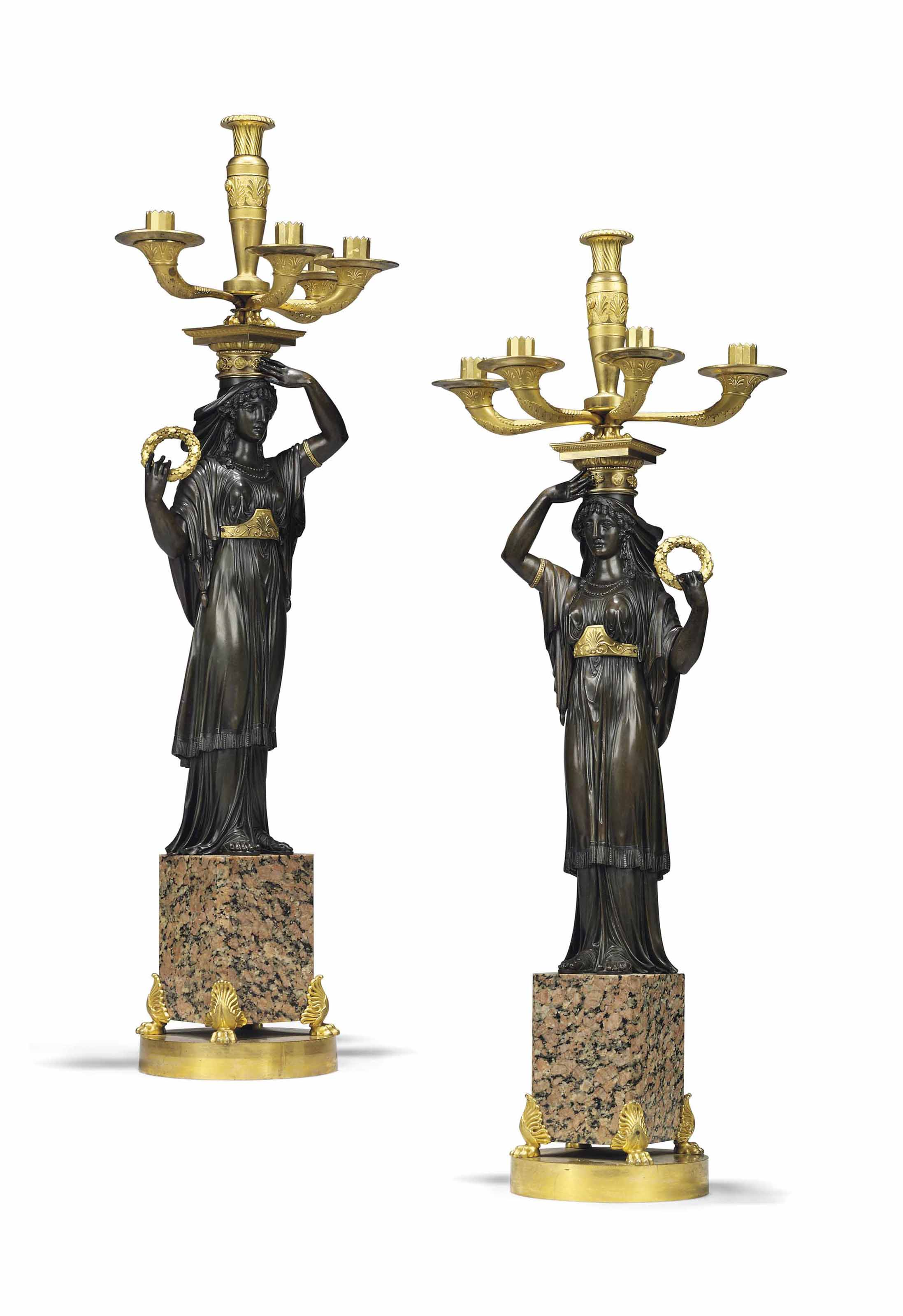 A PAIR OF EMPIRE ORMOLU, PATINATED-BRONZE AND PINK GRANITE FIVE-LIGHT CANDELABRA