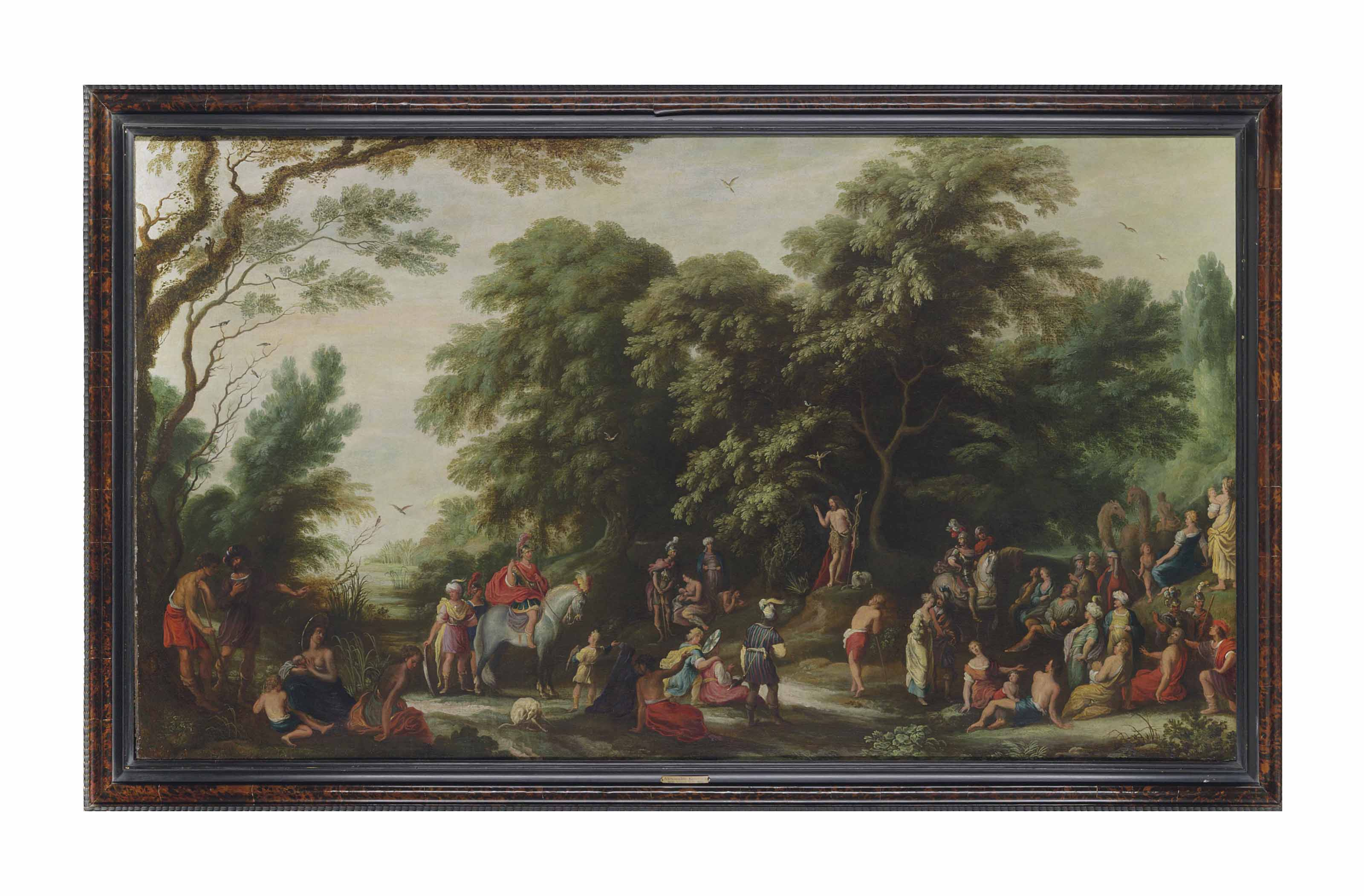 A wooded river landscape with Saint John the Baptist preaching