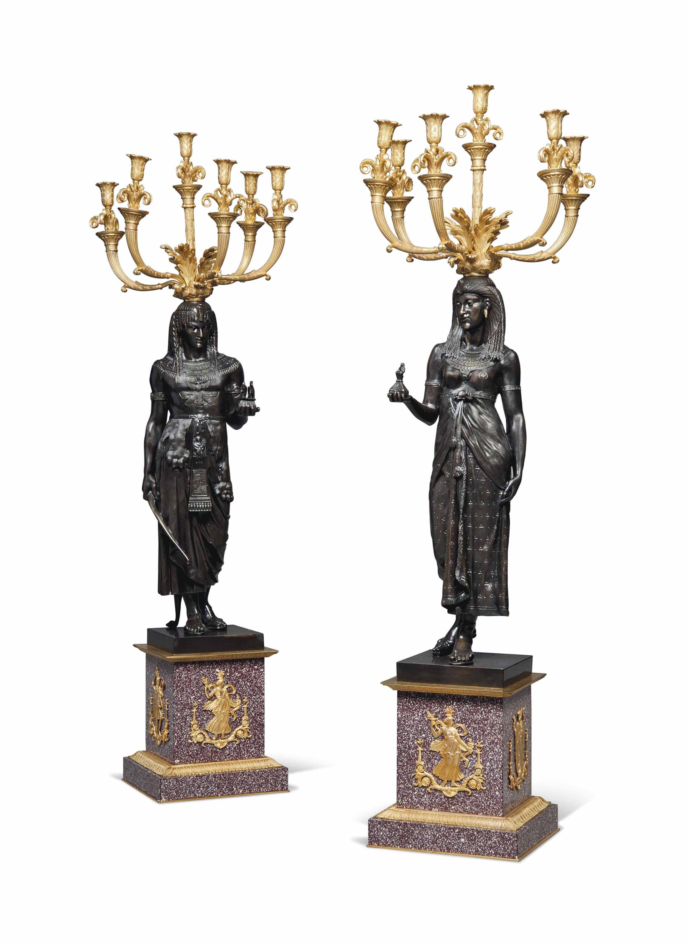 A PAIR OF FRENCH ORMOLU AND PATINATED-BRONZE SIX-LIGHT CANDELABRA