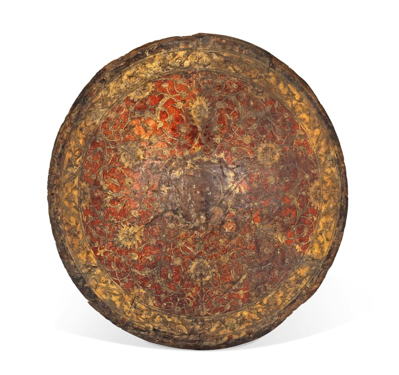 A rare Venetian parade shield, Venice, Italy, second half 16th century. 22 in (56 cm)  diameter. Estimate £50,000-70,000. This lot is offered in Art of the Islamic and Indian Worlds Including Oriental Carpets on 26 October 2017  at Christie's in London