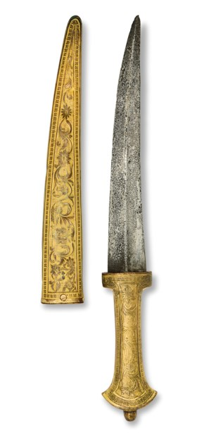 A GILT-COPPER TOMBAK MOUNTED DAGGER AND SHEATH