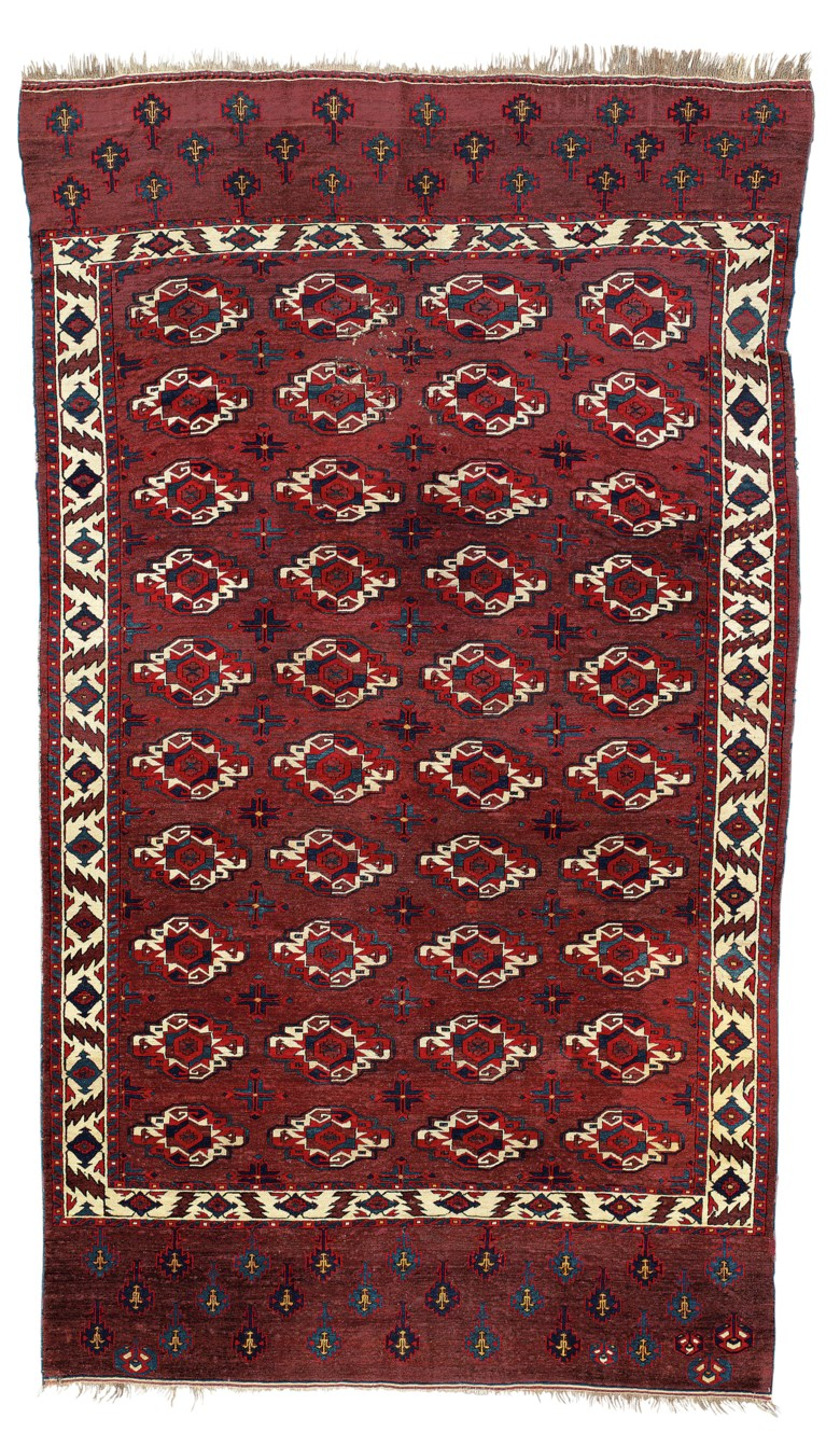 A Yomut main carpet, west Turkmenistan, second half 18th century. 9 ft 11 in x 5 ft 7 in (301 cm x 172 cm). This lot was offered in Art of the Islamic and Indian Worlds Including Oriental Rugs and Carpets on 26 October 2017  at Christie's in London and sold for £27,500