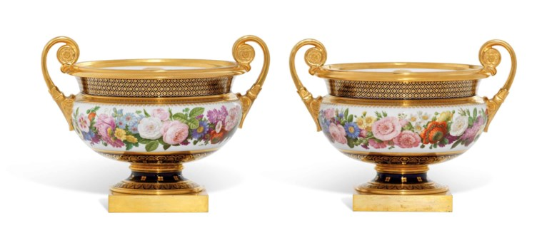 A pair of Sèvres (hard paste) ice-pails, covers and liners (glacière chanou) from the service presented by King Charles X of France to Sir Thomas Lawrence, 1824-25, printed blue crowned interlaced C marks enclosing X with Sèvres and 24 below, painter's DT mark for Gilbert Drouet and various script marks. 9  in (23  cm) high, 11⅝  in (29.5  cm) wide. Estimate