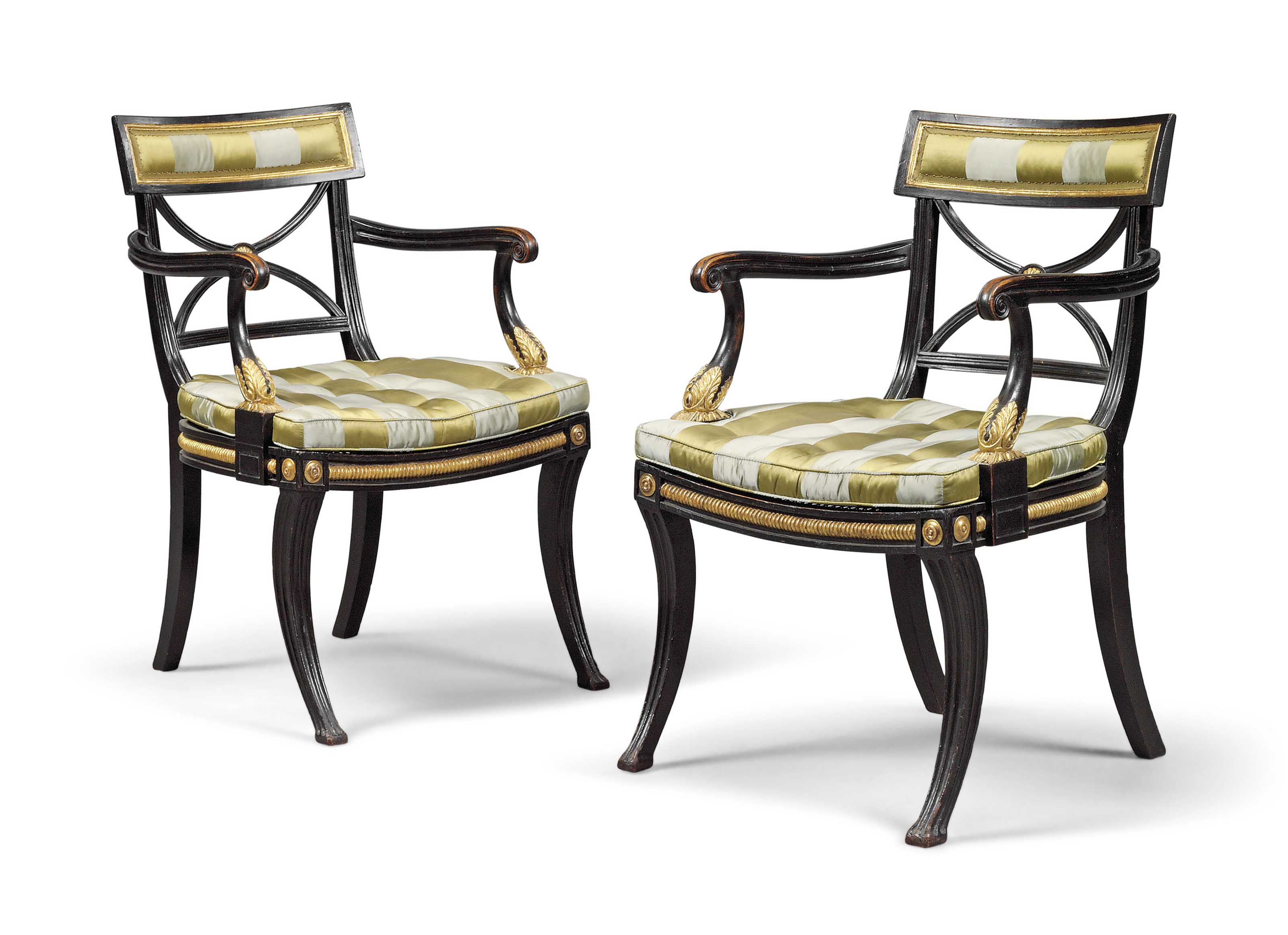 A PAIR OF REGENCY EBONISED AND PARCEL-GILT OPEN ARMCHAIRS