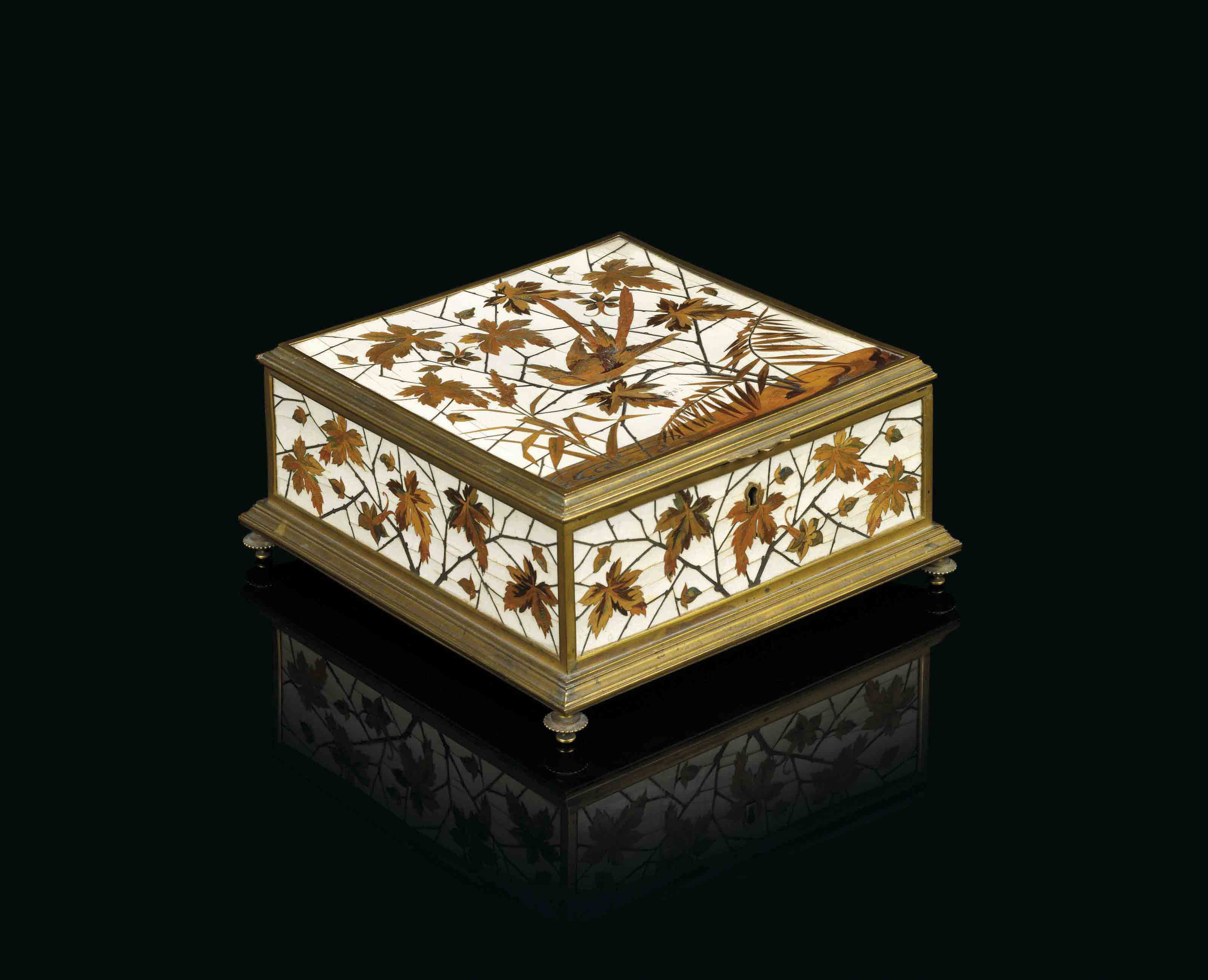 A FRENCH ORMOLU AND FRUITWOOD AND CUT-BRASS-INLAID IVORY MARQUETRY CASKET