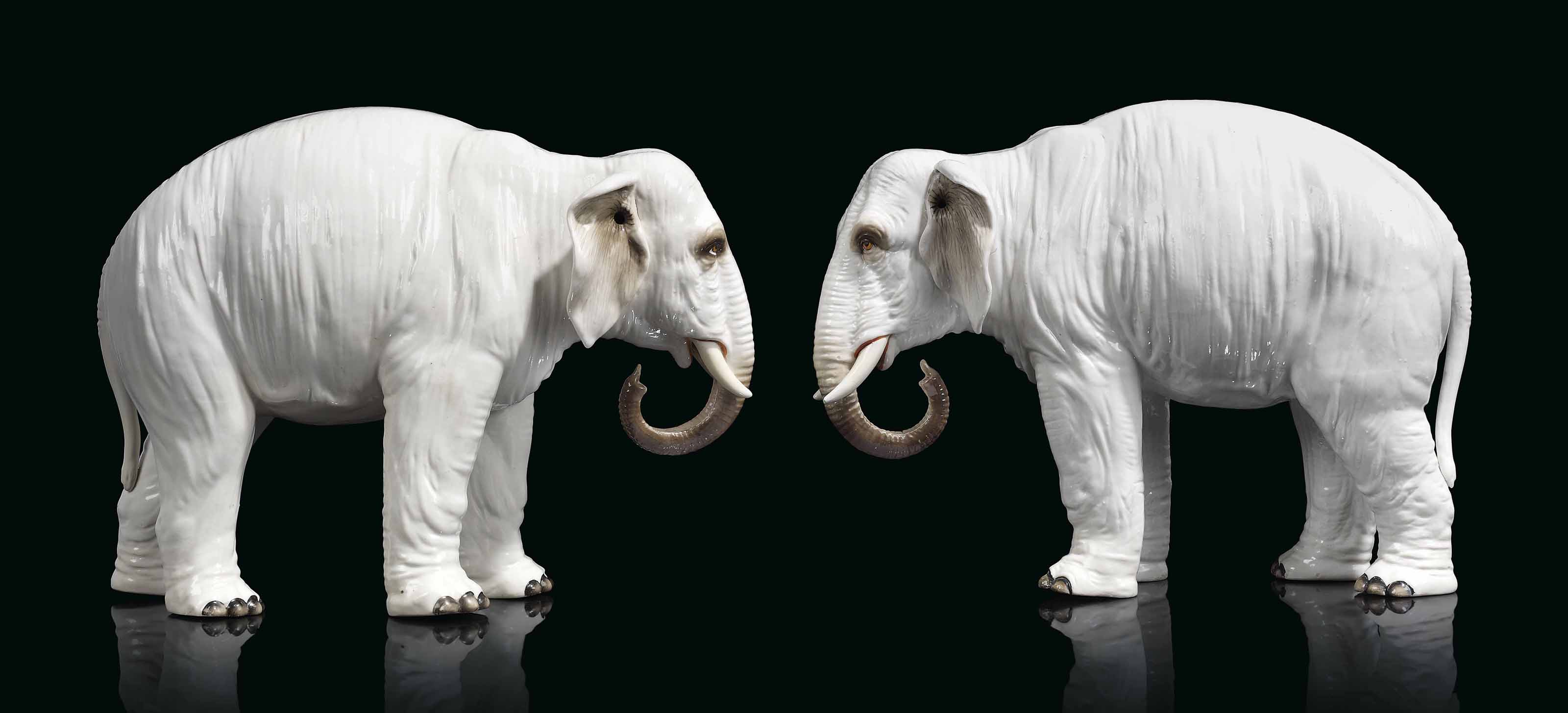 A PAIR OF CONTINENTAL PORCELAIN MODELS OF ELEPHANTS