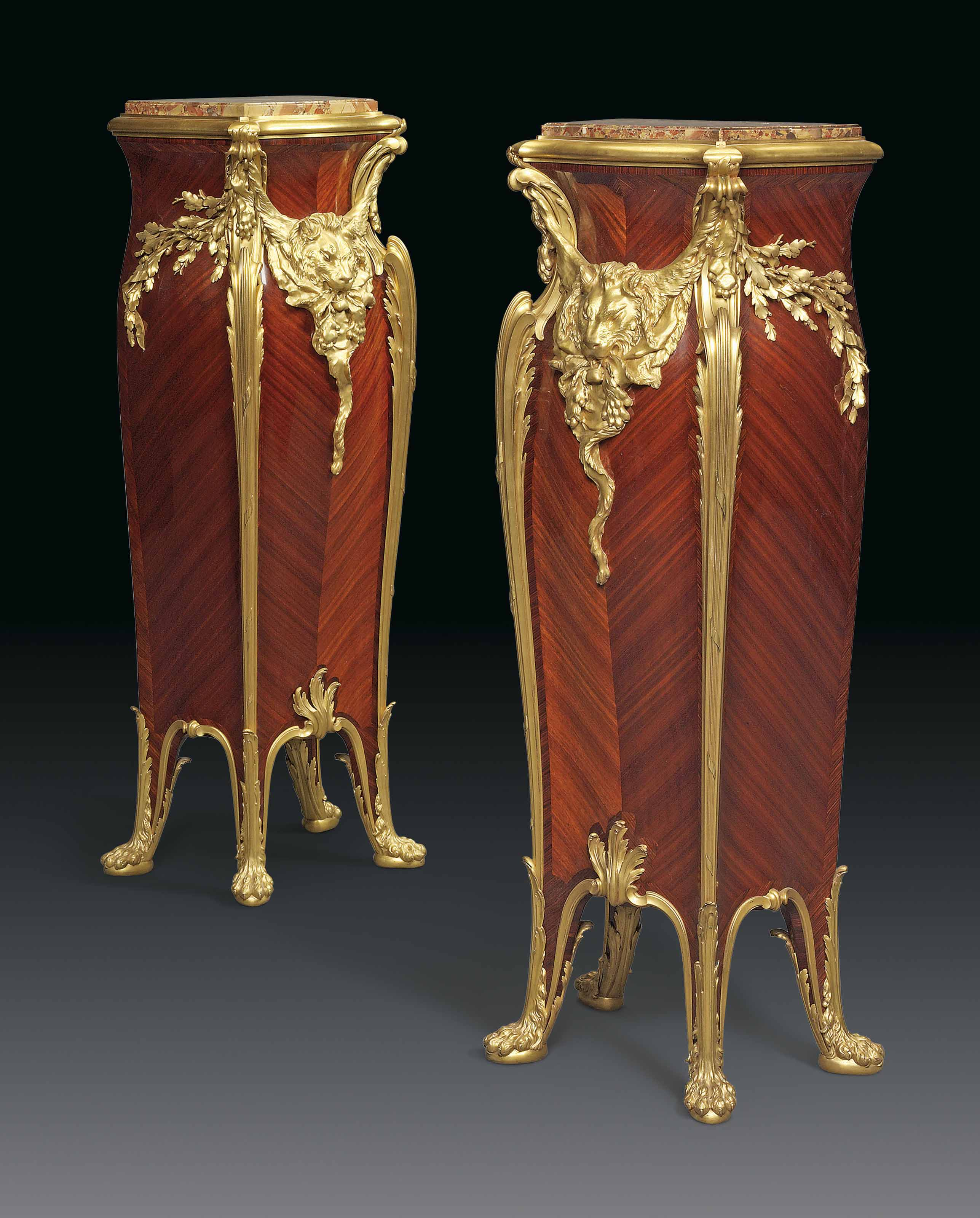 A PAIR OF FRENCH ORMOLU-MOUNTED MAHOGANY AND BOIS SATINE PEDESTALS