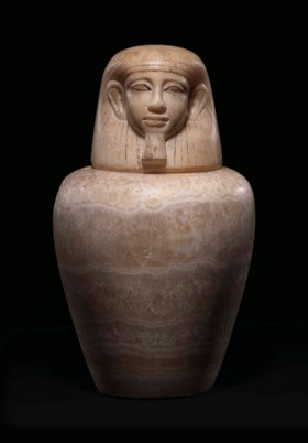 AN EGYPTIAN ALABASTER CANOPIC JAR
