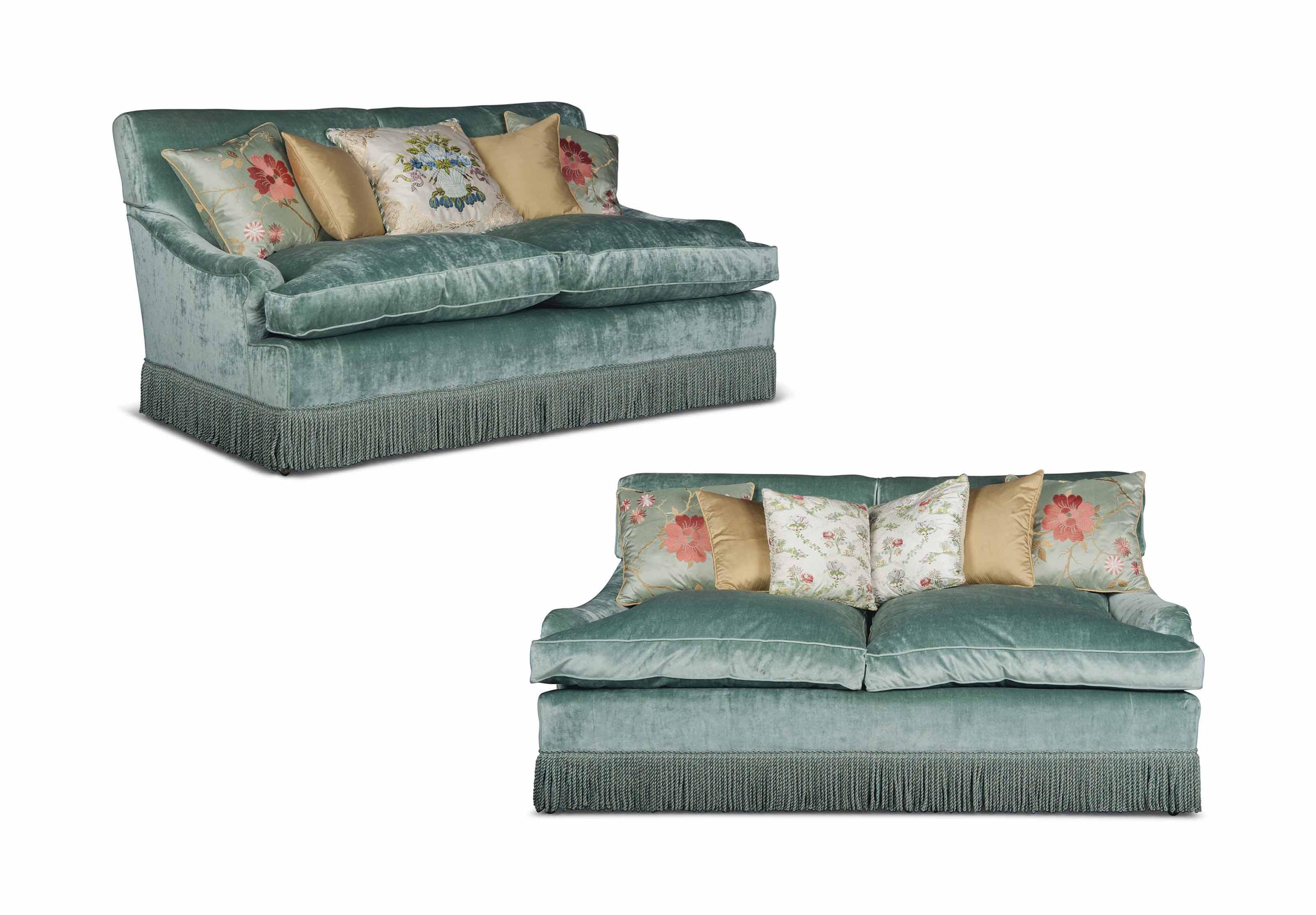 A PAIR OF ENGLISH SEA GREEN VELVET TWO-SEAT SOFAS