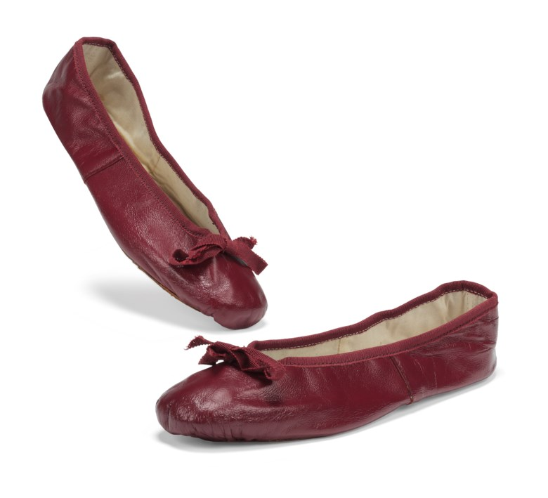 Three pairs of leather ballet pumps, circa 1960. One pair in burgundy trimmed with red ribbon; one in daffodil yellow with yellow ribbon and one pair in emerald green trimmed with Petersham ribbon. Estimate £6,000-9,000. This lot is offered in Audrey Hepburn The Personal Collection on 27 September 2017  at Christie's in London